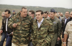 Prime minister Alexis Tsipras with Panos Kammenos, minister of Defence, in military uniforms.